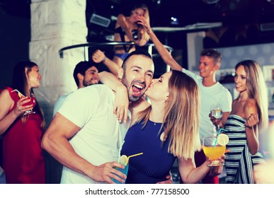 couple of  happy people together in the night club with drinks