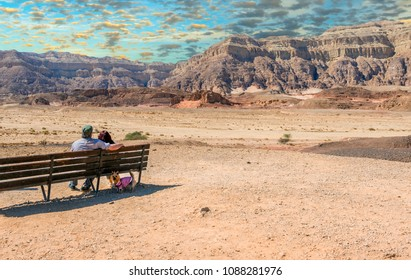Couple of happy seniors looking at  valley of Timna park, that is located 25 km north of Eilat (Israel)