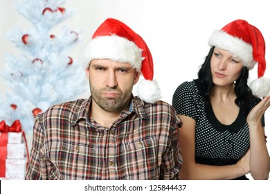 couple has an argument under the christmas tree