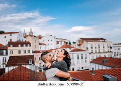 Couple has fun and laughs. kiss. Young hipster couple hugging each other in city. Kove story, a beautiful stylish young couple. Fashion concept with boyfriend and girlfriend in Lisboa.