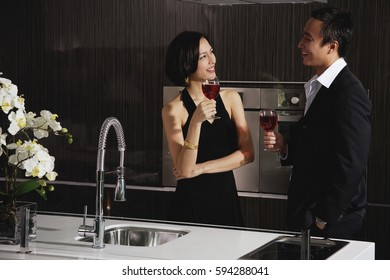 A couple have a glass of red wine together