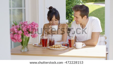 Couple having breakfast at outdoor table
