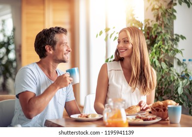 Couple having breakfast in their home.