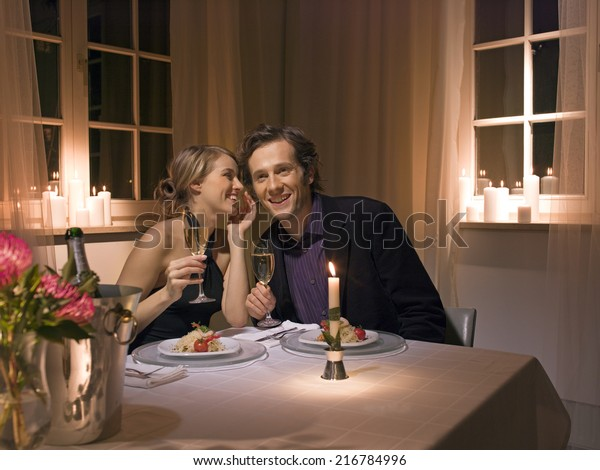 A couple having a candlelight dinner.