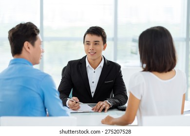 Couple having consultation with real estate broker