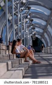 Couple, having a conversation in an urban environment