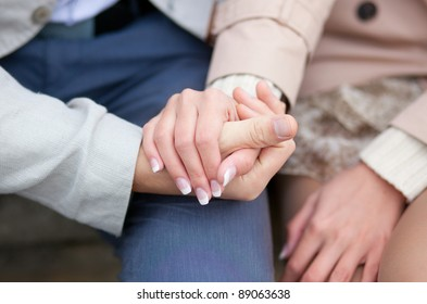 Couple having a date, holding each others hands