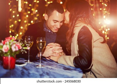 Couple having dinner with champagne glass on a table