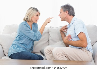 Couple having a fight at home on the couch