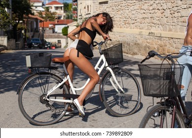 Couple having fun in the city.Happy young couple going for a bike ride on a autumn day in the city. Happy funny young couple riding on bicycle. Love, relationship, romance concept. Sexual photo. Sexy.