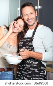 Couple having fun cooking at home
