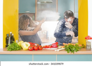 Couple having fun with flour in a kitchen