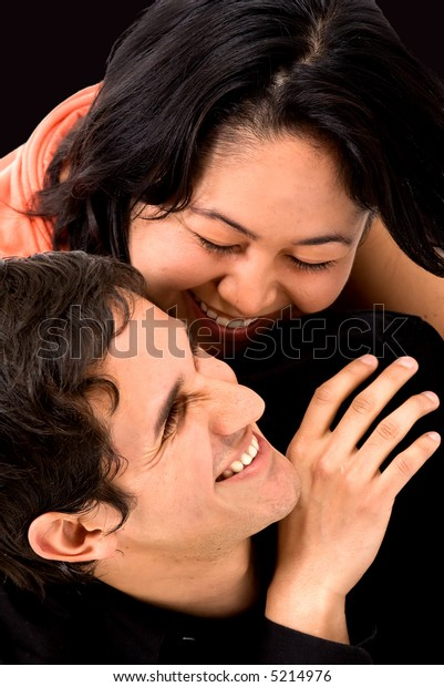 couple having fun over a black background
