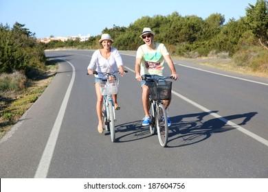 Couple having fun riding bicycles