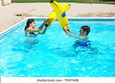 Couple having fun in swimming pool.