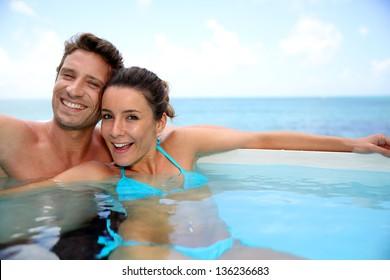 Couple having fun in swimming-pool