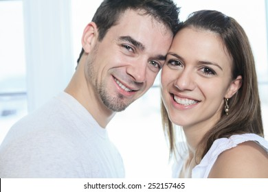 A couple having great time close to the window
