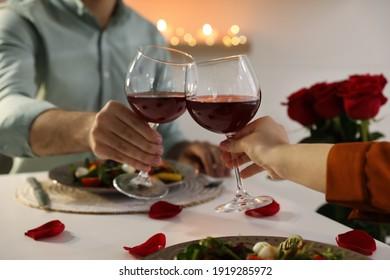 Couple having romantic dinner at home, closeup