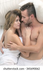 Couple having romantic morning in bed