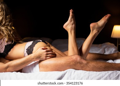 Couple having sex in bedroom