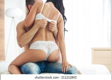 Couple having sex, man take off bra of girl in his lap