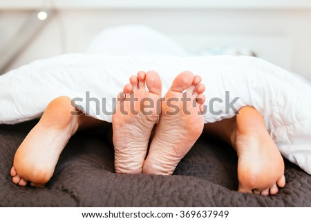 Something holding her feet sex have