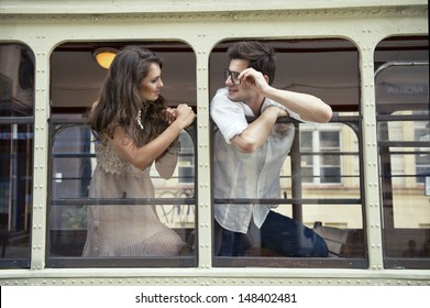 Couple with heads out the train window. Love