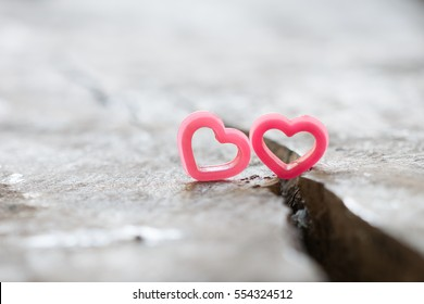 Couple hearts on rift wood.  concept love is not smooth every day some time have quarrel.