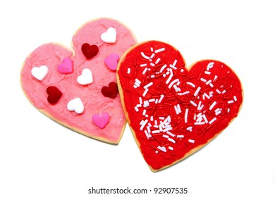 A couple of heart-shaped cookies over white