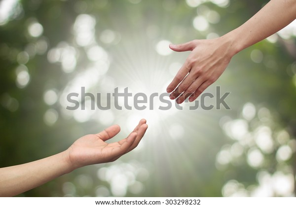 couple help hand blessing praying nature background for spiritual power of life concept.
