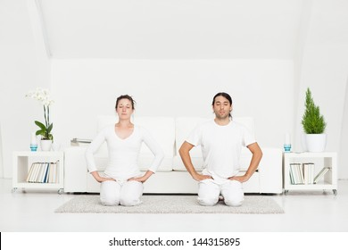 Couple in the Hero yoga position.