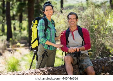 Couple hiker taking a break on the wood