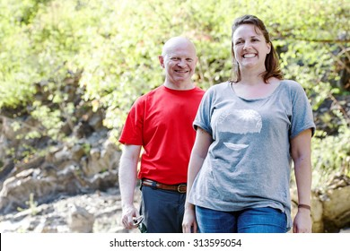 couple of hikers against natural background