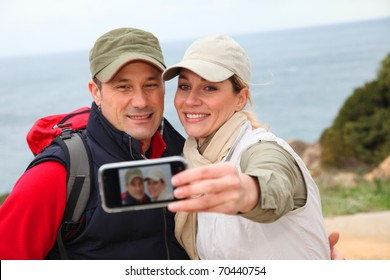 Couple of hikers taking picture of themselves