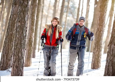 Couple of hikers in winter hiking together