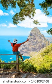 couple hiking in the mountains Saint Lucia Caribbean, nature trail in the jungle of Saint Lucia with a look at the huge Pitons