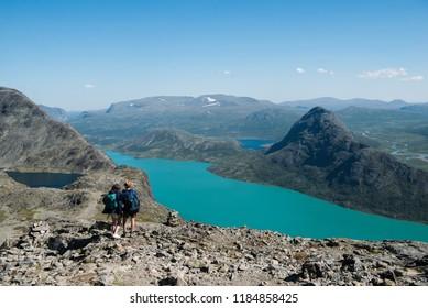 couple hiking on Besseggen ridge in Jotunheimen National Park, Norway