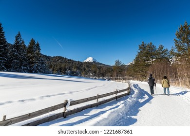couple hiking in Seefeld in Tyrol on a sunny winter day