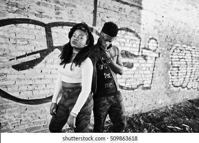 Couple of hip-hop afroamerican on undergraund. Black and white photo