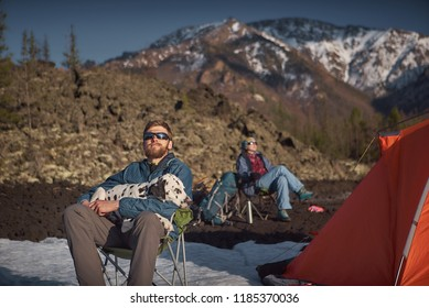 Couple with his dalmatian dog at camping outdoors mountain terrain