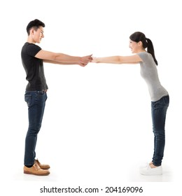 Couple hold hands, full length portrait isolated on white background.