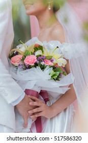 Couple holding a bouquet of flowers with a happy wedding day is the symbol of love.