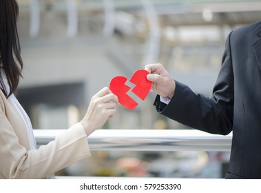couple holding broken heart,Sad concept