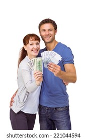 Couple holding fans of cash on white background