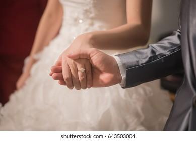Couple holding hand in weddingday