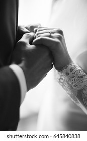 Couple holding hands, hands of the bride and groom close-up, engagement ring for the bride, couple on wedding day, touching moment, wedding ceremony, Hands of lovers, wedding day