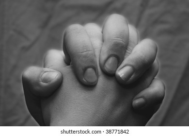 A couple holding hands close up .