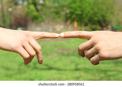 Couple holding hands on blurred background