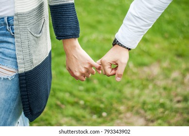 Couple holding hands and walk