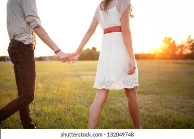 Couple Holding Hands Walking Away